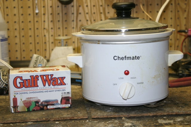 Paraffin Wax can be found in the canning isle.  Now its time to get melty, you need something to heat up the Paraffin Wax to around 150 degrees.  Be careful this stuff will catch on fire if you get it too hot.