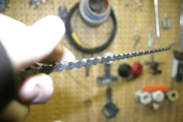 Once the chain comes out you must let it cool.  The hardened wax will make the chain stiff, but once it runs it'll be smooth.